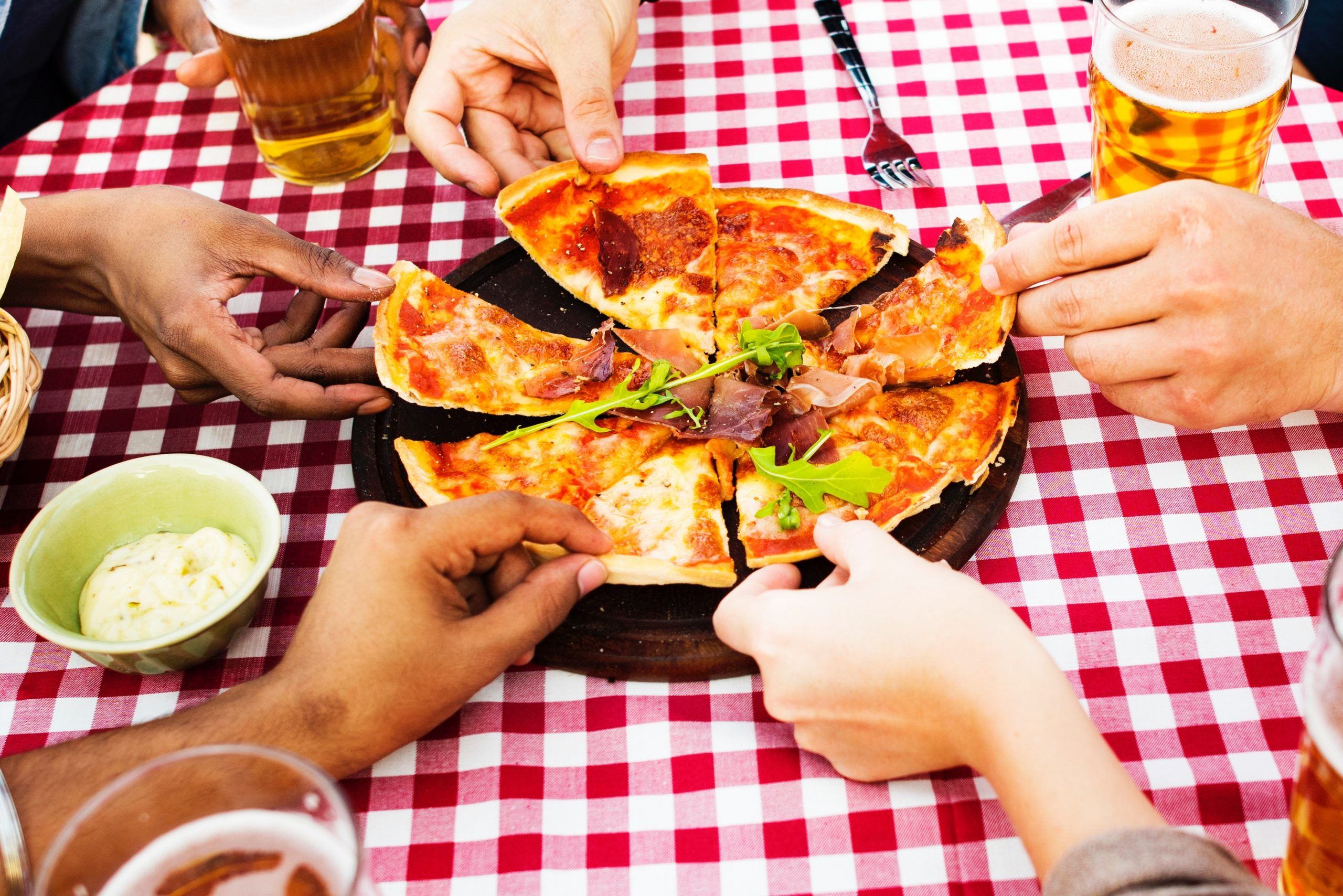 friends enjoying pizza and beers