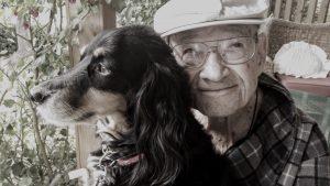 Elderly man with pet dog