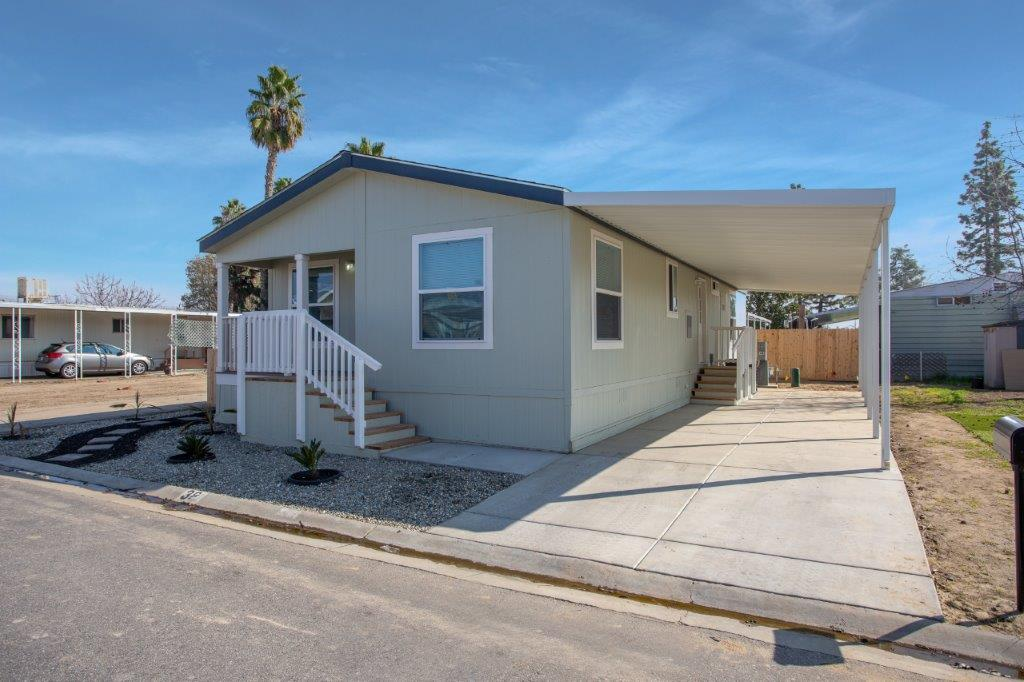 double wide mobile home with indoor car park